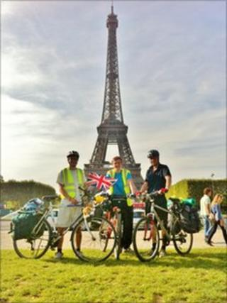William Ingram, Conrad Godfrey, and Hallam Duckworth next to the Eiffel Tower in Paris