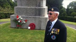 Roy Goddard near the memorial