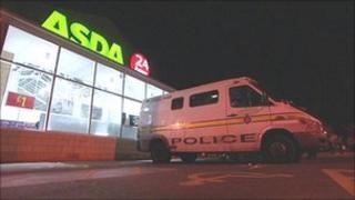 Police van outside Asda store