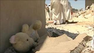 A teddy bear in the rubble