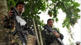 A file photo taken on September 19, 2009 shows members of the Moro Islamic Liberation Front (MILF) near Camp Darapanan in the town of Sultan Kudarat