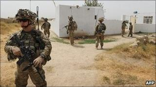 US troops accompanied by Afghan soldiers on patrol in Kandahar province, southern Afghanistan