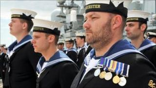 Servicemen during the decommissioning ceremony for the HMS Gloucester in Portsmouth