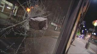 A brick hurled through shop window in Leicester
