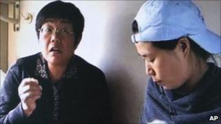 Internet activist Wang Lihong (L) in a video clip