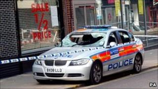 A damaged police car on Enfield High Street, north London