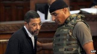 Ali Seriati, Tunisia's former security chief, arrives for a trial hearing at a court in Tunis on 26 July.