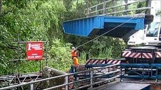 Bridge being lifted into place