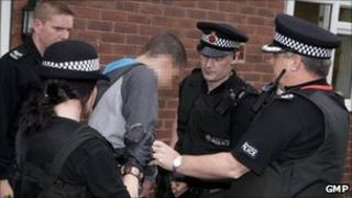 Rioter being arrested by GMP