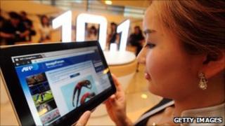 Woman looking at Samsung Galaxy Tab