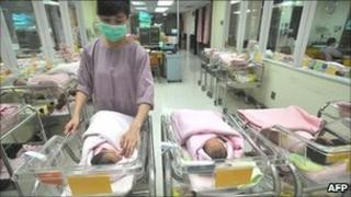 A nurse inspects newborn babies at a hospital in Taipei