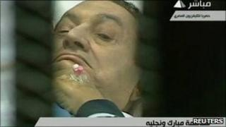 Former Egyptian President Hosni Mubarak is seen in footage from the courtroom during his trial