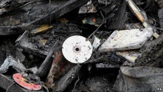 CDs lie among wreckage at the Sony Distribution Centre in Enfield