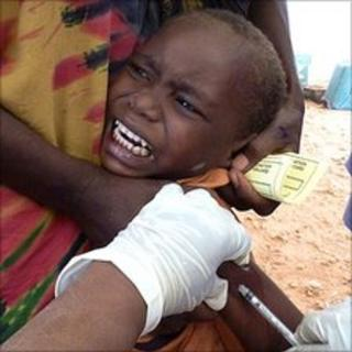 A Somali boy refugee is vaccinated against measles
