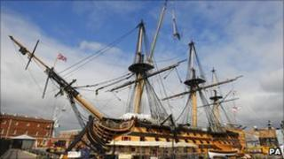 Riggers removing the main topgallant mast from HMS Victory in Portsmouth