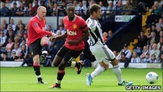 Manchester United striker Wayne Rooney scores the opening goal against WBA
