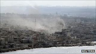 Smoke rises from the coastal Syrian city of Latakia