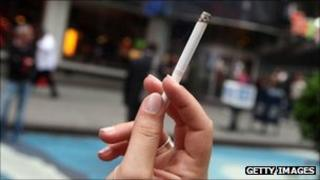 Cigarette held by aloft in New York