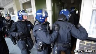 Met Police carry out a raid in London