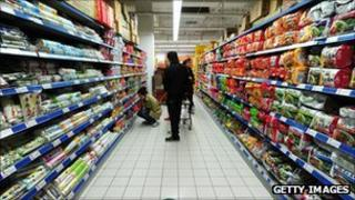 A man browses the shelves in a Beijing supermarket