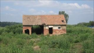 A house damaged by the sludge