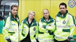 BBC Casualty paramedics standing in front of an ambulance