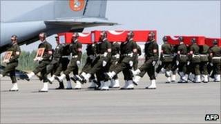 Turkish soldiers carry the coffins of soldiers who were killed in Cukurca