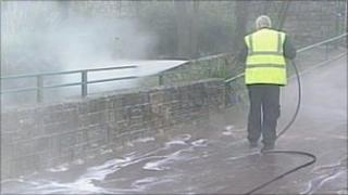 Council worker disinfecting footpaths in Bournemouth Lower Gardens
