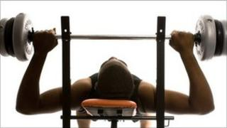 Man lifting weights in a gym