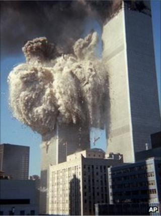 twin towers burns in the background