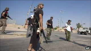 Libyan rebel fighters seen at the checkpoint outside Zawiya, Libya, Saturday, Aug. 20, 2011