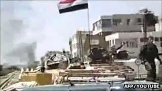 An image grab taken from a video uploaded on YouTube shows Syrian security forces taking position in the city of Hama. Date: 19 August 2011