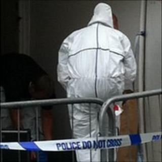 Police officers investigating in the Bordage, St Peter Port