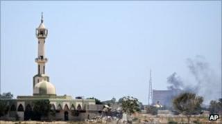 Smoke rises over buildings in the main compound of Muammar Gaddafi in the Bab Al-Aziziya district of Tripoli