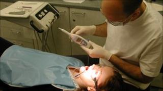 Dentist using the CarieScan device