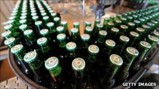Heineken bottles on a production line