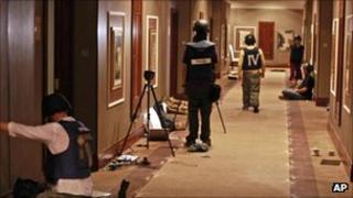 Journalists in corridor