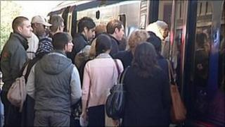 Passengers queuing to get onto FTPE train