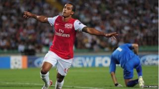 Arsenal player Theo Walcott celebrates scoring against Udinese