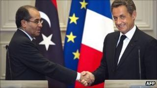 French President Nicolas Sarkozy shakes hand with the number two in Libya's NTC Mahmoud Jibril after a joint press conference in Paris on 24 August 2011