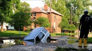 Car stuck in a sinkhole in Detroit