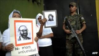 Human rights activists and relatives of victims of El Salvador's civil war demonstrated outside the military base