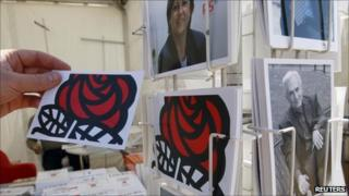 Postcards of Martine Aubry and Dominique Strauss-Kahn are displayed on a stand at the French Socialist Party conference in La Rochelle, 26 August