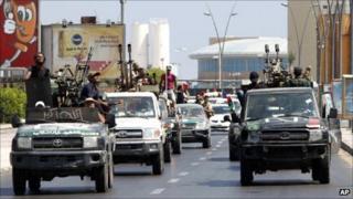 Rebel fighters search for Libyan leader Muammar Gaddafi's forces in Tripoli, Libya, 26 August 2011