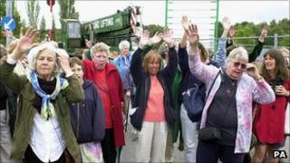 Peace camp members watch the last caravan leave in September 2000