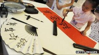Young girl painting calligraphy in Tianjin