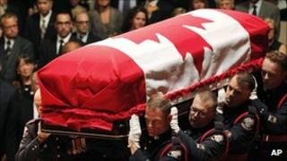 Jack Layton's coffin is carried into Roy Thomson Hall 27 Aug