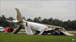 A Gulf Air passenger plane lies on the ground after it skidded off the runway at Kochi International Airport in southern India on 29 August 2011