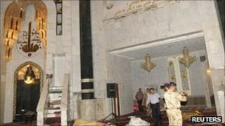 Security personnel inspect site of bomb attack in Umm al-Qura mosque in Baghdad