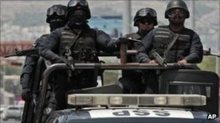 Federal police on patrol in Monterrey on 28 August